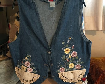 Lovely jean vest. All hand made and hand painted the floral on the vest Size L