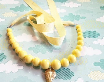 Going out of business Sale Pale yellow repaired ribbon necklace