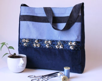 light blue and blue door hand shoulder bag marine with bordered gallon