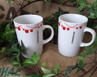 A pair of Starbucks Coffee Mugs 2012