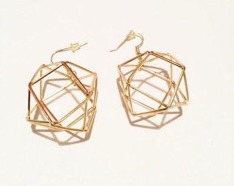 Gold tone rubix cube earrings