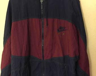 Nike X champs, vintage, full zip windbreaker with hood.