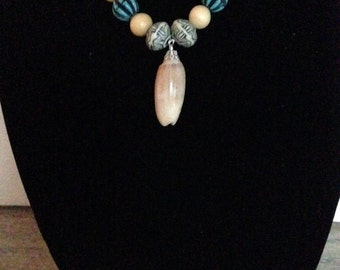 """Handmade 20"""" Silver Necklace with Olive Shell."""