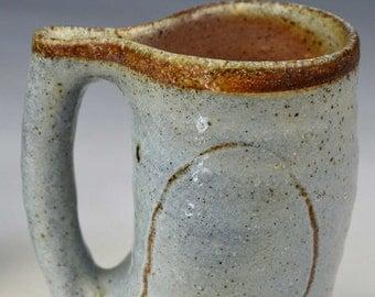 pinched handle mug