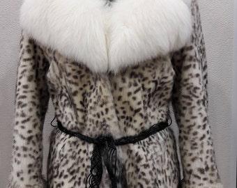 New elegant fur coat from nutria. Collar fox . Collection 2017 .
