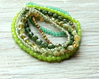 6 Strands of Green Glass Beads