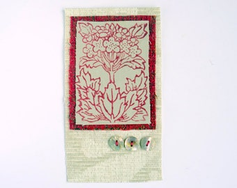 Original textile art / small applique. Recycled fabric, red flower print, buttons, collage, embroidery. Neutrals/red.