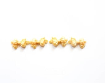 90's Bow Barrettes Set in GOLD SHIMMER . Set of 4 . 1990s kid nostalgia . small bows . plastic . golden orange yellow glitter