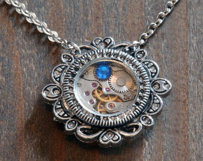 Steampunk Jewelry - Pendant - Watch movement and capri blue crystal