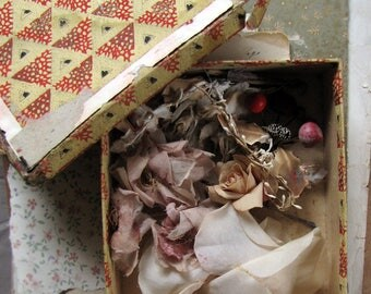 antique millinery flowers - tattered blooms in a tattered old box, perfect for assemblage work or display