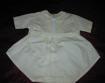 Vintage pale yellow baby romper.Feltman Bros.Size newborn -3months.Great for that special little one,photo prop,large doll,nursery,collect