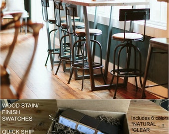 Counter Height Reclaimed Wood Bistro Table with steel base and stools. Purchase a Finish/stain sample kit here