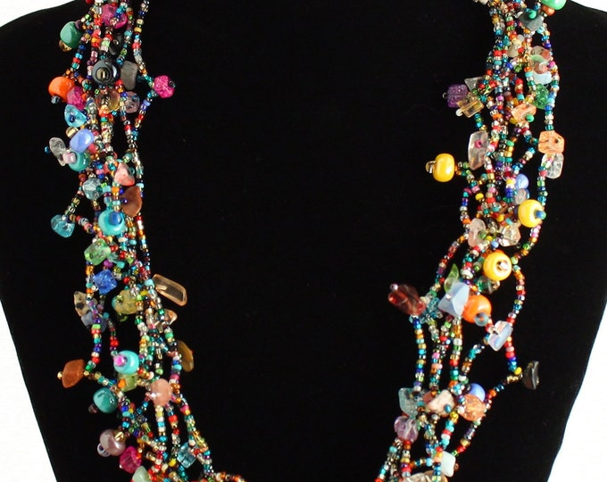 Hand beaded multicolored multistrand necklace, magnetic clasp, 24 inches #101