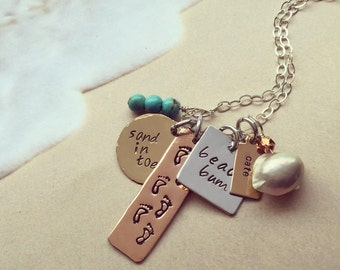 Its a day at the Beach charm necklace. Gold-filled, Sterling Silver, Copper and Bronze.
