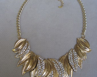Overlaping Curved Plain and Crystal Gold Leaves Bib Necklace