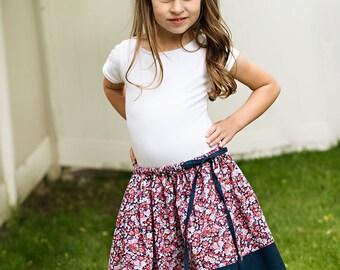 Girls twirly floral skirt, navy bottom panel, tie waist, sizes 12 m to 12 years drawstring