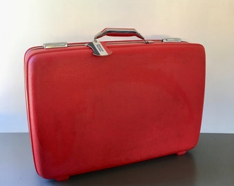 vintage red large American Tourister hard sided suitcase luggage