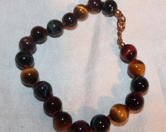 A knotted Three Colour Tigerseye Bracelet