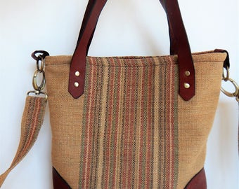 Shoulder or tote bag with leather trim.  Crossbody bag with leather trim.