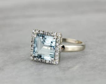 Superior Aquamarine and Diamond Halo Ring in White Gold N86T27-P