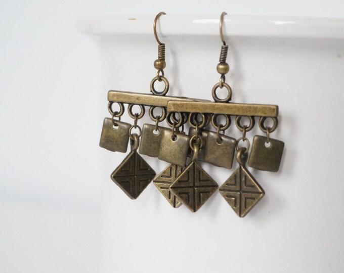 Bronze earrings monkeys.