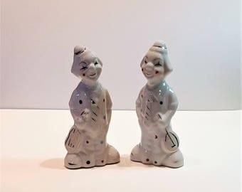 Set of Two Vintage Porcelain Clown Musician Figurines presented by Donellensvintage