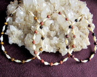 Bracelets, champagne color freshwater pearls, three different gemstone, tigereye, red tigereye, goldstone, 12k golddfilled beads and clasp.
