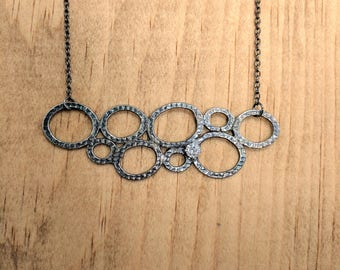 Circles. Sterling silver necklace with white CZ...................................................................boho round black geometric
