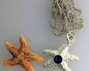 Sterling silver sand cast starfish with blue paua shell pendant