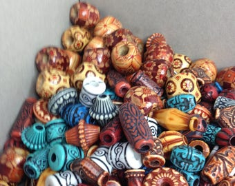 NEW LISTING - Bagful of beads - #J54 - 12.4 oz - 150 count assorted carved resin and brown designed beads