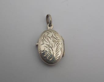 Vintage pendant is photo or reliquary in Silver 925