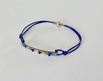 Glass and blue enamel bracelet.