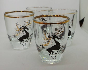 Vintage glass - set of four vintage shot glasses decorated with reindeer.