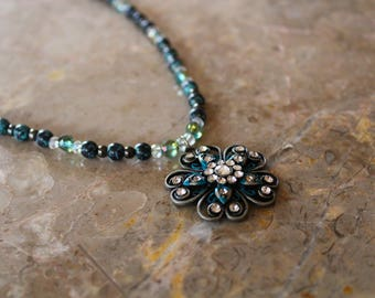 Teal colored, flower like, beautiful necklace