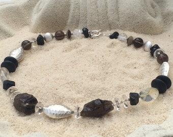 Smoky quartz and rock crystal and tourmaline
