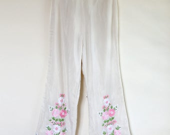 Handmade cream flare pants with floral embroidery and scallop detailing