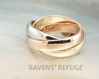 Tricolor rolling rings in 14k gold -- interlocking bands of three colors in rose gold, yellow gold and white gold