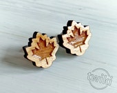 Maple leaf wood earring studs. -- maple leaf earrings, maple leaf wood earrings, canada earrings, maple leaf studs, maple leaf stud earrings