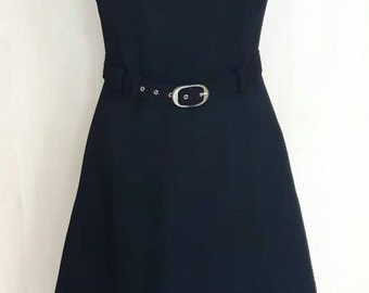 Vintage 1970s little black sleeveless dress fitted to the waist with matching belt