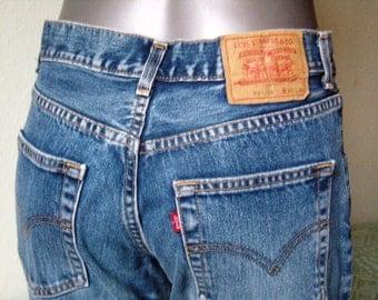 Levis 525 jeans size high retro jeans, denim blue, Capri pants, flared leg pants vintage stretch, medium, size 30.