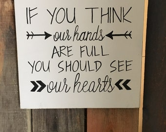 If You think our hands are full you should see our hearts wood sign