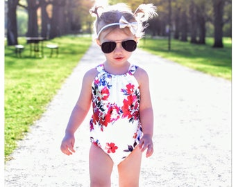 White Metallic Floral Lower Back Bow Tie Baby Romper - Sunsuit