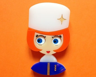"""White and Blue Girl Acrylic brooch """"ANA"""". A vintage inspired redhead girl coming from the great cold, wearing a white chapka"""