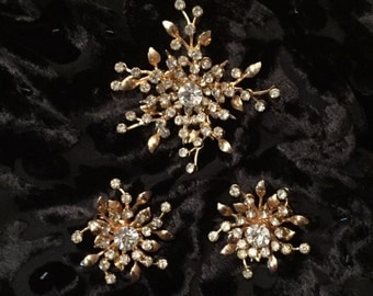 Sale! Free Shipping! Beautiful Vintage set of Coro jewelry from 1950's. Rhinestone Brooch and Matching Clip Earrings in a Sunburst Design.
