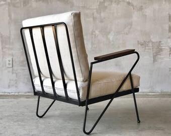 Mid Century style iron lounge chairs.