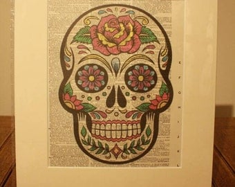 """Ideal gift, Dictionary art print sugar skull printed on 1907 dictionary sheet in a 12"""" x 14"""" cream mount."""