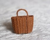A miniature biscuit brown basket