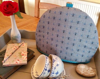 Tea cosy, tea cozy, with a bee print fabric, bees are blue on a grey background, fits a four to six cup teapot.