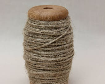 Turned oak bobbin of garden twine