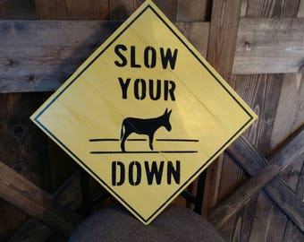 Slow your Ass Down (donkey) pallet sign.